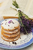 A stack of lavender biscuits on a plate