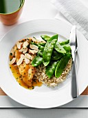Chicken breast with orange sauce, natural rice and mange tout