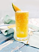 A refreshing drink made with oranges, carrots and yellow pepper