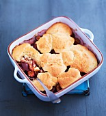 Plum cobbler in a baking dish