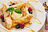 Banana-filled taquitos with vanilla ice cream, fresh berries and caramel sauce