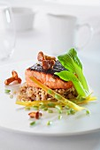 Salmon fillet with chanterelle mushrooms on a bed of barley