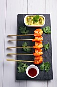 Prawn skewers with guacamole and coriander