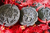 Pu-ehr tea cakes shaped like coins with Chinese writing
