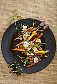 Colourful carrot salad with almond nougat and cress