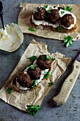Ciabatta with meatballs and harissa sour cream