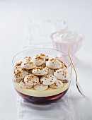 Poached peach and rosé trifle topped with meringue