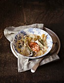 Grilled salmon in a creamy fennel and mushroom soup with shallots