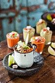 Tomato soup with harissa and cold avocado soup with dukkah