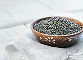 Lentils in a brown ceramic bowl