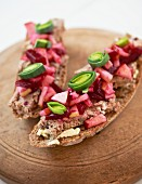 Slices of bread topped with liver pâté, beetroot and leek