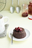 A mini chocolate cake with cranberry sauce