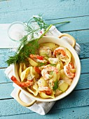 Shell pasta with prawns and an orange sauce