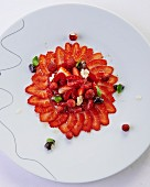 Strawberry carpaccio with wild strawberries