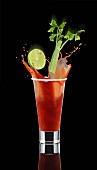 A Bloody Mary splashing out of the glass