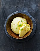 Citrus fruit ice cream garnished with lime zest