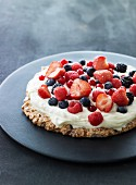 Berry cake topped with cream