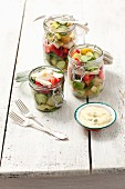Chicken salad with strawberries, green beans, potatoes and cucumber