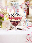 A summer berry trifle topped with cream