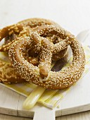 A sesame seed pretzel and a cheese pretzel