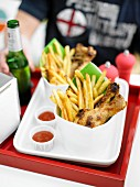 Chicken drumsticks and French fries