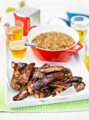 Pork ribs served with baked beans and beer