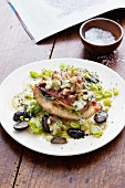 A stuffed turkey escalope on a leek medley with grapes