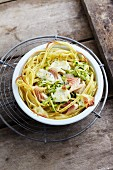 A spaghetti nest with courgette and smoked salmon trout fillet