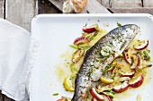 Salmon trout with apple wedges and cider