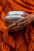 A Buddhist monk waiting to receive alms, Battambang, Cambodia
