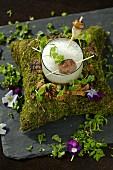 Porcini mushroom soup with fresh moss foam and a venison meatball