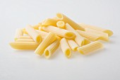 A pile of fresh Penne Rigate pasta