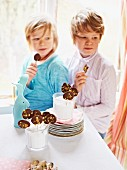 Children eating chocolate lollies at Easter