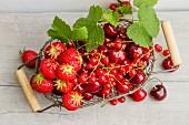 An arrangement of red summer fruits (seen from above)