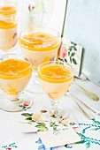 Mango and peach pudding in desert glasses