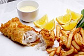 Battered hake with a dip and chips