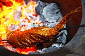 Tandoori fish over glowing coals
