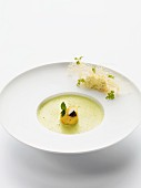Chervil foam soup with baked quail's eggs and caviar