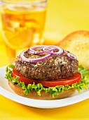 A hamburger with tomatoes and lettuce