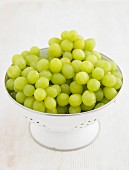 Green grapes in an enamel colander