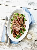 Salad with vegetables, rump steak and couscous