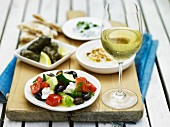Greek food, white wine and unleavened bread