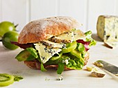 Ciabatta sandwich with green tomato, avocado and blue cheese