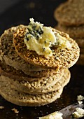 A stack of poppy seed and oat biscuits with Stilton