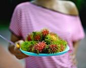 A plate of rambutans