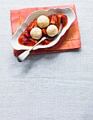 Quark dumplings on a bed of strawberry compote