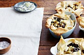 Aubergine tartlets made from malsouka pastry with beans and olives