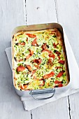 Quiche with salmon and courgette in a baking tin