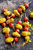 Potato and tomato skewers with curry sauce