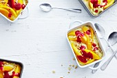Semolina desert with yoghurt, mango wedges and raspberry sauce